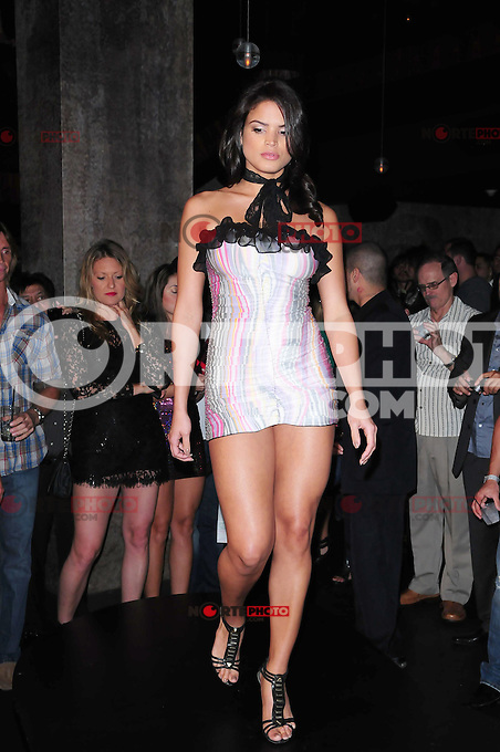MIAMI BEACH, FL - MARCH 03: A model walks the runway during the Haute CUTure Fashion Show and Red Carpet Event showcase host by World renowed designer of Lady Gaga's Meat Dress Franc Fernandez at STK at the Gansevoort Hotel on March 03, 2011 in Miami Beach, Florida. (Photo by MPI10/MediaPunch Inc.)