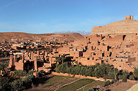 Ksar Ait Ben Haddou, earthen fortified city, Ounila valley, Ouarzazate province, Morocco. The ksar is a group of earthen houses surrounded by high defensive walls with corner towers, in traditional pre-Saharan style.  The village stands above the Oued Marghen river in the High Atlas and was a stop on the caravan route from the Sahara to Marrakech. It was founded in the 17th century and has been a UNESCO World Heritage Site since 1987. Picture by Manuel Cohen