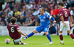 Hearts v St Johnstone...14.08.10  .Jody Morris is tackled by Ruben Palauelos.Picture by Graeme Hart..Copyright Perthshire Picture Agency.Tel: 01738 623350  Mobile: 07990 594431