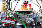 Steeve Pedone of Sunnyvale decorates his 1948 Chrysler Traveler with holiday decorations before the 37th annual Festival of Lights Parade begins.