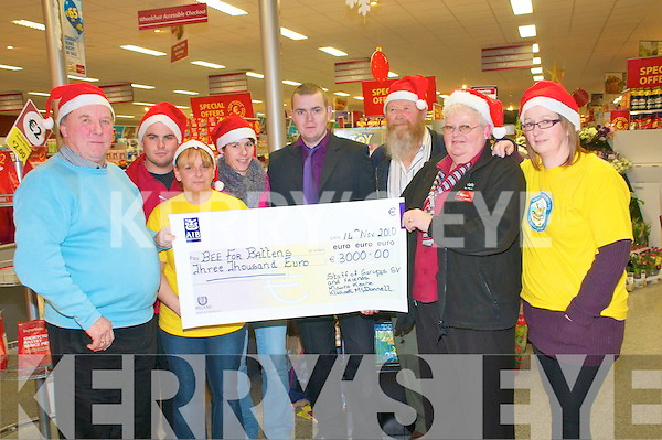 Presentation: Mike McDonnell, Manager Galvey Super Value, Listowel  centre, presenting a cheque for EUR3000.00 to the Bee for Battens organization, the proceeds of the Pre Xmas Crack night held at the Kingdom Bar in Listowel on 14th November. L-R: Jim Burke, Sean Henchy, Carol White, Sabrina Murphy, Mike McDonnell, Peter Duncombe, Maureen Keane & Sharon Boyle.