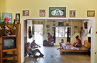 Inside Nauruan houses...Nauru, officially the Republic of Nauru is an island nation in Micronesia in the South Pacific.  Nauru was declared independent in 1968 and it is the world's smallest independent republic, covering just 21 square kilometers..Nauru is a phosphate rock island and its economy depends almost entirely on the phosphate deposits that originate from the droppings of sea birds. Following its exploitation it briefly boasted the highest per-capita income enjoyed by any sovereign state in the world during the late 1960s and early 1970s..In the 1990s, when the phosphate reserves were partly exhausted the government resorted to unusual measures. Nauru briefly became a tax haven and illegal money laundering centre. From 2001 to 2008, it accepted aid from the Australian government in exchange for housing a Nauru detention centre, with refugees from various countries including Afghanistan and Iraq..Most necessities are imported on the island..Nauru has parliamentary system of government. It had 17 changes of administration between 1989 and 2003. In December 2007, former weight lifting medallist Marcus Stephen became the President.