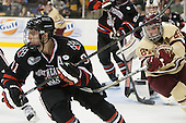Robbie Vrolyk (NU - 91), Steven Whitney (BC - 21) - The Boston College Eagles defeated the Northeastern University Huskies 6-3 on Monday, February 11, 2013, at TD Garden in Boston, Massachusetts.