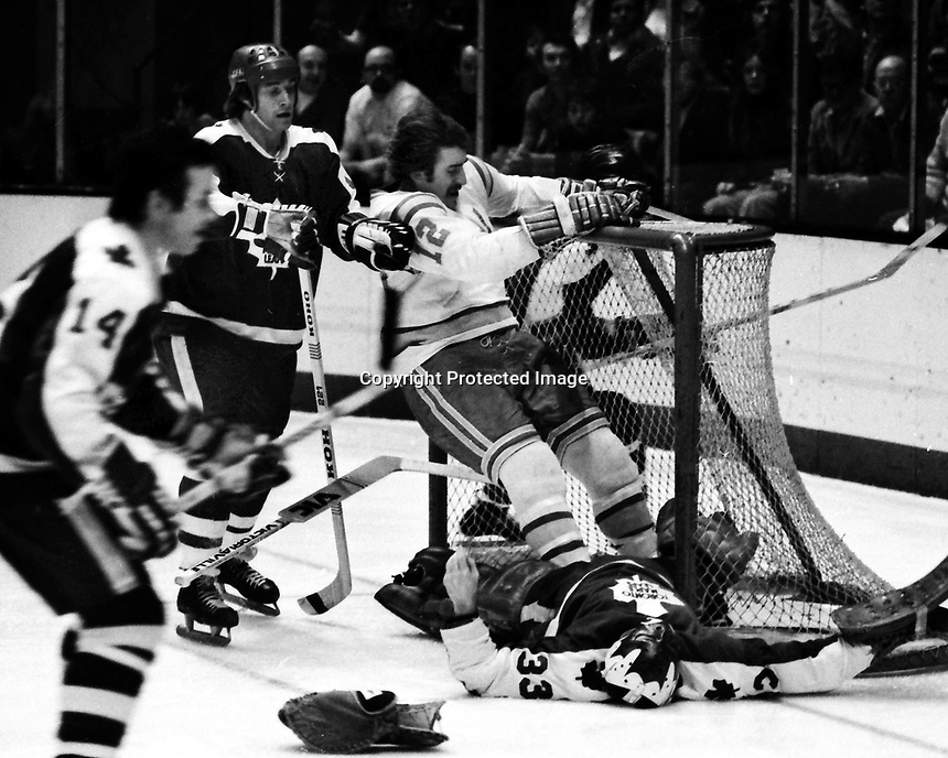 Seals vs Toronto Maple Leafs 1975, Seals Butch Williams crashes Leafs goalie Doug Favell, Inge Hammarstrom. (photo/Ropn Riesterer)
