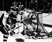 Seals vs Toronto Maple Leafs 1975, Seals Butch Williams crashes Leafs goalie Doug Favell, Inge Hammarstrom. (photo/Ropn Riesterer)