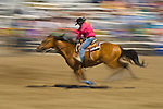 A woman barrel racing at the Jordan Valley Big Loop Rodeo