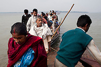 Local villagers travel to and from the islands by wooden boats in Sundarban, West Bengal, India, on 18th January, 2012. The Sundarban islands and mangroves are sinking, say experts, due to climate change. Locals say they are overwhelmed by tourists' trash that affect the mangroves and sudden changes in weather patterns that have caused such damage that they continue to struggle to recover. One of the islands, once inhabited, has slowly sunk. Photo by Suzanne Lee for The National (online byline: Photo by Szu for The National)