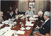 United States President Ronald Reagan holds a National Security Council Meeting on the hijacking of TWA flight 847 in the Situation Room at the White House in Washington, DC on June 16, 1985.  Left to right: unidentified; Secretary of Defense Caspar Weinberger; Vice President George H.W. Bush; U.S. President Ronald Reagan; Secretary of State George Schultz; CIA Director William Casey; and White House Chief of Staff Donald Regan.<br /> Credit: White House photo via CNP