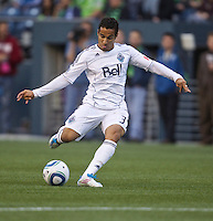 Vancouver Whitecaps FC  midfielder Camilo Sanvezzo takes a shot on goal during play against the Seattle Sounders FC at Qwest Field in Seattle Saturday June 11, 2011. The game ended in a 2-2 draw.