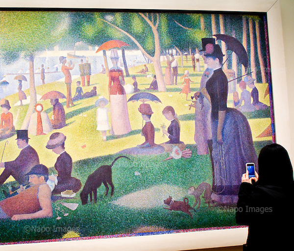 """CHICAGO, ILLINOIS, USA 29 APRIL, 2012:.Muslim woman and a paiting """"A Sunday Afternoon on the Island of La Grande Jatte"""" by Georges Seurat, at the Art Institute of Chicago.(Photo by Piotr Malecki / Napo Images)..CHICAGO, ILLINOIS, USA 29/04,2012:.Muzulmanka i obraz """"Niedzielne popoludnie na wyspie La Grande Jatte"""" Geaorge'a Seurata, w Art Institute of Chicago..Fot: Piotr Malecki / Napo Images"""