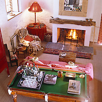 View looking down from the gallery to the cosy living room decorated in warm tones of red