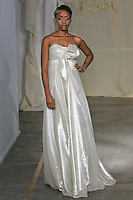 Model walks runway in a Silver Maple wedding dress by Carol Hannah Whitfield, for the Carol Hannah Spring Summer 2012 Bridal collection runway show.