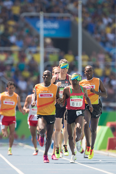 RIO DE JANEIRO - 11/9/2016:  Jason Dunkerley and his guide Josh Karanja compete in the Men's 1500m - T11 Heat at the Olympic Stadium during the Rio 2016 Paralympic Games in Rio de Janeiro, Brazil. (Photo by Matthew Murnaghan/Canadian Paralympic Committee