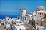 If you ever get to the island of Santorini, Greece, walk and explore. You'll find these windmills at the end of the little town of Oia on the edge of the caldera.