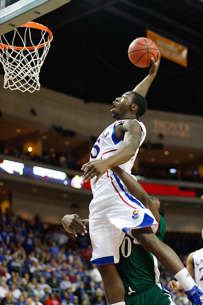 Nov. 26, 2010. Las Vegas, NV: The Kansas Jayhawks' Elijah Johnson is intentionally fouled by   Ricardo Johnson as he dunks in the Las Vegas Invitational at the Orleans Arena.