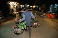 Midnight radish delivery on Ganga Path New Road in Kathmandu City, Nepal