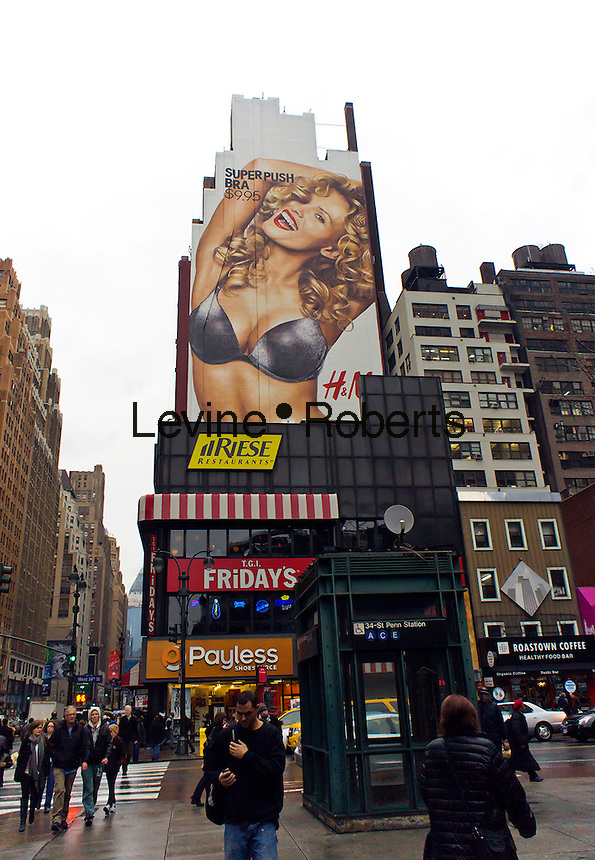 """A billboard for H&M's """"sexy push-up bra"""" in the Herald Square shopping district in New York is seen on Wednesday, December 21, 2011.  (© Richard B. Levine)"""