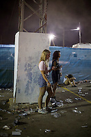 BENIC&Agrave;SSIM, SPAIN - A festival goer checks her mobile phone during a set by German DJ Boys Noize at the Festival Internacional de Benic&agrave;ssim...Described by some as a Mediterranean Glastonbury, the Festival Internacional de Benic&agrave;ssim (FIB) is the largest music festival outside the UK to target British visitors. In 2010, seven of the eight main headline slots were filled by English bands...A small coastal town of 13,000 inhabitants, Benic&agrave;ssim hosted some 200,000 visitors in 2009, with 40% of those believed to be coming from the UK. In 2010, attendances fell to 127,000 visitors but the percentage of UK visitors is believed to have risen.