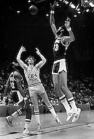 Warriors Rick Barry trys to shoot over Kareem Addul-Jabbar..Warriors vs Lakers 1977. (photo/<br />