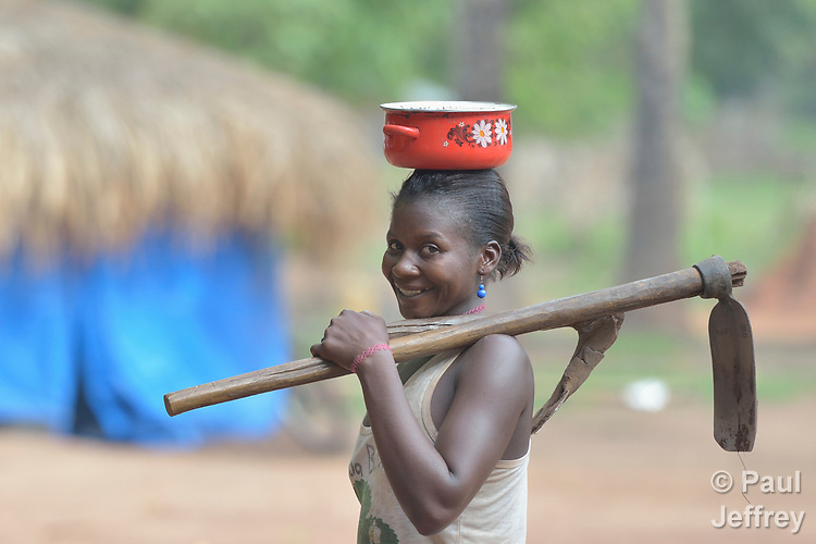 A woman with tools in a camp for for than 5,000 displaced people in Riimenze, in South Sudan's Gbudwe State, what was formerly Western Equatoria. Families here were displaced at the beginning of 2017, as fighting between government soldiers and rebels escalated.<br /> <br /> Two Catholic groups, Caritas Austria and Solidarity with South Sudan, have played key roles in assuring that the displaced families here have food, shelter and water.<br /> The camp formed around the Catholic Church in Riimenze as people fled violence in nearby villages for what they perceived as the safety offered by the church.