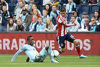 Mechack Jerome (24) defender Sporting KC tackles Jorge Villafana (19) midfield Chivas USA ..Sporting Kansas City defeated Chivas USA 4-0 at Sporting Park, Kansas City, Kansas.