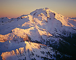 Aerial of sunset highlighting snowy ridges at Glacier Peak, Glacier Peak Wilderness Area, North Cascades Mountain Range, Washington State