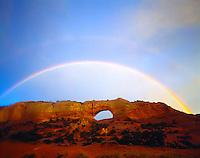Rainbow at Wilson Arch, San Juan County, Utah    Natural sandstone arch near Moab, Utah