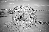 A makeshift shelter made of sticks at the Dadaab refugee camp. The drought is the worst in East Africa for 60 years. The UN described it as a humanitarian emergency. The already overcrowded complex received 1,000 new refugees a day in June, five times more than a year ago. About 30,000 people arrived at the Dadaab refugee camp in June, according to UNHCR compared to 6,000 in June 2010.