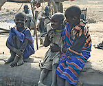 Dinka children grow up in a cattle camp near Akot, South Sudan.  South Sudan is still recovering from generations of civil war.