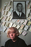 Denise Stanley mother of Benji Stanley beneath a photograph of her son who was killed in while out playing on his bike during a shoot out in a drug related crime. 1993. Moss Side Near Manchester. England.