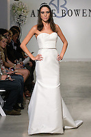 "Model walks runway in a Cariad Bridal gown - strapless ivory chiffon gown with rose beaded bodice, from the Anne Bowen Bridal Spring 2013 ""Coat of Arms"" collection fashion show, during Bridal Fashion Week New York April 2012."