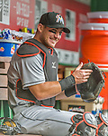 30 August 2015: Miami Marlins catcher Jeff Mathis dons his gear in the dugout prior to facing the Washington Nationals at Nationals Park in Washington, DC. The Nationals defeated the Marlins 7-4 in the third game of their 3-game weekend series. Mandatory Credit: Ed Wolfstein Photo *** RAW (NEF) Image File Available ***