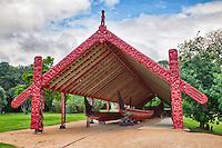 Maori War Canoe Ngatokimatawhaorua (on right), built in 1940 by the Maori Nga Puhi people to celebrate the centenary of the signing of the Treaty of Waitangi.  35 meters long, 2 meters wide.  Waitangi Treaty Grounds, Paihia, north island, New Zealand.