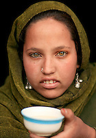 A Gujjar girl with a cup of salt tea..Lidderwat, Kashmir, India.