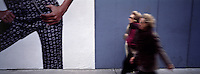 """Out takes from """"The Harvard Design School Guide to Shopping"""" published by Tashen. A huge advertisement on the upper east side is put into perspective by two women walking infront of it. NY 2000"""