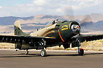 Astronaut Bill Anders taxies the Heritage Flight Musuem's Douglas A-1D Skyraider at Stead Field in Nevada. While an Air Force pilot Bill Anders was selected as an astronaut in 1963 and served as the backup command module pilot for the Apollo 11 mission. The William A. Anders Foundation is the sponsor of the Heritage Flight Musuem, located in the State of Washington, and Bill flies its aircraft to many airshows throughout the country. Photographed 09/07