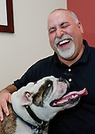 Veterinary surgeon,Dr.Litzman, shares a moment with his patient,Stanley, in Scottsdale,AZ.