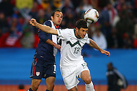 Landon DOnovan (L) of USA and Bojan Jokic (R) of Slovenia