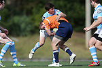 27 September 2014: North Carolina's Cameron Hardie (9) makes a defensive play. The University of North Carolina Tar Heels hosted the University of Virginia Cavaliers at Hooker Field in Chapel Hill, NC in a 2014-15 USA College Rugby match. North Carolina won the game 27-12.