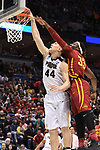 MILWAUKEE, WI - MARCH 18: Purdue Boilermakers center Isaac Haas (44) makes a dunk past Iowa State Cyclones forward Solomon Young (33) during the first half of the 2017 NCAA Men's Basketball Tournament held at BMO Harris Bradley Center on March 18, 2017 in Milwaukee, Wisconsin. (Photo by Jamie Schwaberow/NCAA Photos via Getty Images)