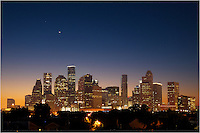 Early one morning, about 30 minutes before sunrise, the crescent moon rises in the east over the Houston skyline in this sleep image from the largest city in Texas. With clear skies, I enjoyed the color gradient from orange to blue as the sliver of light rose above the quiet lights of downtown.