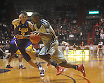"Ole Miss forward Terrance Henry (1) against Louisiana State's Garrett Green (3) at the C.M. ""Tad"" Smith Coliseum in Oxford, Miss. on Wednesday, February 9, 2011. Ole Miss won 66-60 and is now 4-5 in the Southeastern Conference."