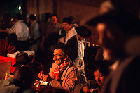 "Campesinos eat dinner at small food stands in the local produce market in Vallegrande, Bolivia Sunday, Nov. 14, 2004. Ernesto ""Che"" Guevara was captured by the Bolivian army in 1967 in a nearby valley and executed in La Higuera days later. His body was put on public display in the laundry room of the Vallegrande hospital, then secretly buried under the air strip for 30 years. Guevara and fellow communist guerillas were attempting to launch a continent-wide revolution modeled on Guevara's success in Cuba in the late 1950s. The Bolivian government recently began promoting the area where he fought, was captured, killed and burried for 30 years as the ""Ruta del Che,"" or Che's Route. (Kevin Moloney for the New York Times)"