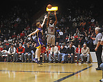"Ole Miss guard Zach Graham (32)  shoots over Louisiana State's Eddie Ludwig (13)  at the C.M. ""Tad"" Smith Coliseum in Oxford, Miss. on Wednesday, February 9, 2011. Ole Miss won 66-60 and is now 4-5 in the Southeastern Conference."