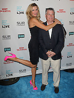 Brandi Glanville &amp; guest.Bravo's Andy Cohen's Book Release Party For &quot;Most Talkative: Stories From The Front Lines Of Pop Held at SUR Lounge, West Hollywood, California, USA..May 14th, 2012.full length black dress pink shoes suit jacket white shirt beige trousers side leg foot up.CAP/ADM/KB.&copy;Kevan Brooks/AdMedia/Capital Pictures.