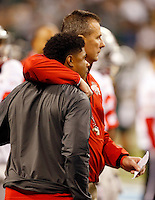 Ohio State Buckeyes head coach Urban Meyer hugs safety Christian Bryant prior to the Big Ten championship football game against the Michigan State Spartans at Lucas Oil Stadium in Indianapolis on Dec. 7, 2013. Bryant's season ended with a broken ankle against Wisconsin. (Adam Cairns / The Columbus Dispatch)