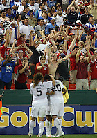 Kyle Beckerman #5 of the USA congratulates Santino Quaranta #20 after Quaranta's goal during a CONCACAF Gold Cup match against Honduras at RFK Stadium on July 8 2009 in Washington D.C. USA won the match 2-0.