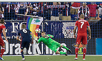 Foxborough, Massachusetts - August 9, 2016: First half action. 2016 Lamar Hunt U.S Open Cup Semifinal, New England Revolution (blue) defeated Chicago Fire (red), 3-1, at Gillette Stadium.<br /> Penalty kick converted.