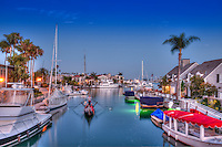 Naples Canal, CA. Belmont Shore, Long Beach, CA, Dusk, Canal  Houses, Lit, Blue Sky, Water Reflections, Luxury Homes
