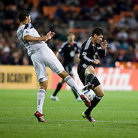 Santino Quaranta (25) of D.C. United collides with Omar Gonzalez (4) of the LA Galaxy  during the game at RFK Stadium.  D.C. United tied the LA Galaxy, 1-1.